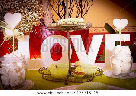 Wedding table with sweets and the word love