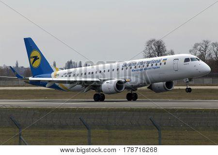 Borispol, Ukraine - March 25, 2017: Ukraine International Airlines Embraer ERJ190-100 aircraft landing on the runway of Borispol International Airport on March 25, 2017. Editorial use only
