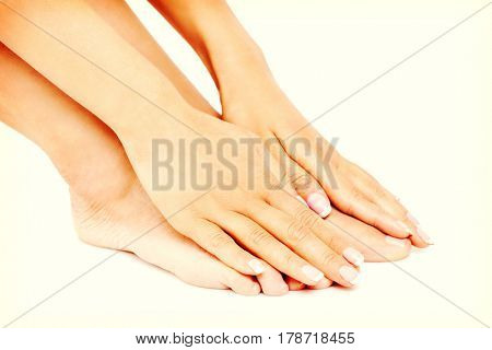 Young woman touching her feet