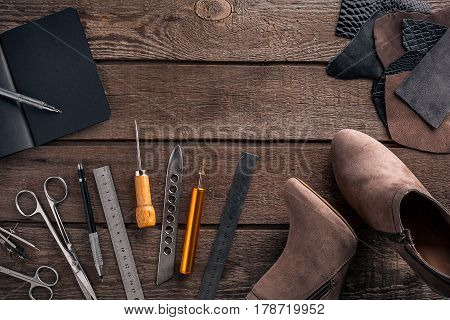 Leather crafting. Tools flat lay still life. Top view. Copy space