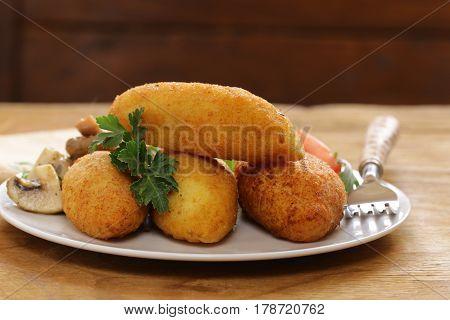 Vegetarian potato cutlets ,  with vegetable salad