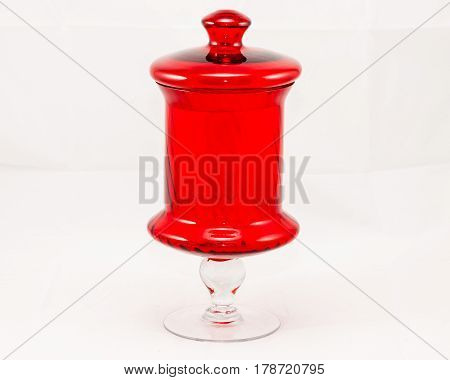 a round tall red jar (12 inches tall)