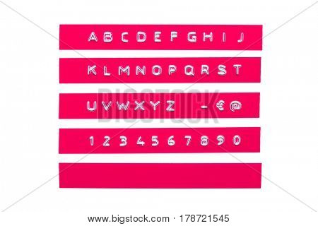embossed alphabet on pink plastic tape, isolated on white