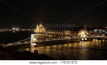 Night panorama of Budapest, view from Buda Castle to Parliament building, Chain Bridge and Danube