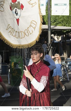 VALLADOLID, SPAIN - JULY 25, 2016: Valladolid (Castilla y Leon Spain): religious procession of Santiago a young woman with traditional costume