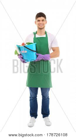 Young man holding bucket with cleaning supplies on white background