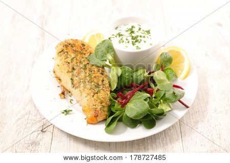 fried chicken fillet with salad and sauce