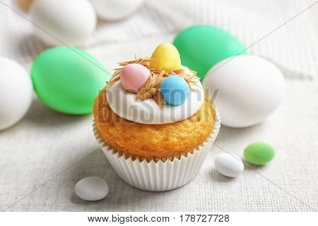 Sweet Easter cupcake on linen tablecloth