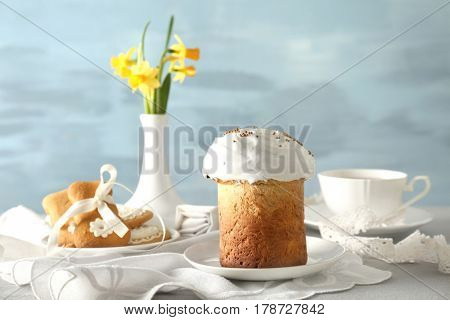 Beautiful composition with Easter cake on blurred background