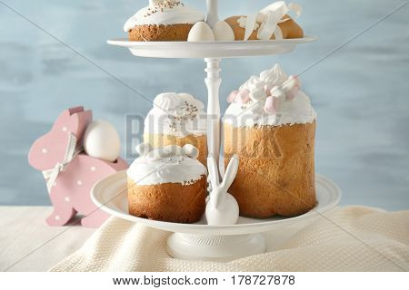 Dessert stand with traditional Russian Easter cakes on table