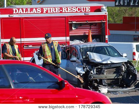 Dallas,USA,28th March 2017. The second major accident at this intersection in recent days. There appears to be no injuries as the EMS arrived, investigated and departed from the scene on 26th March here in Dallas.