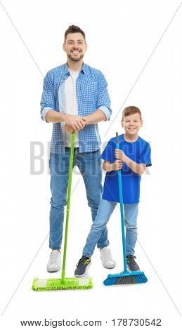 Dad and son with cleaning supplies on white background