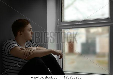 Handsome depressed man at home