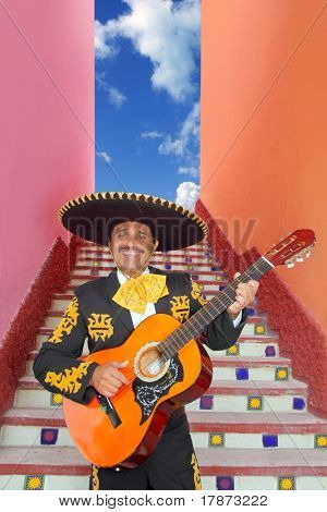 Charro Mariachi singer playing guitar in Mexico stairway poster