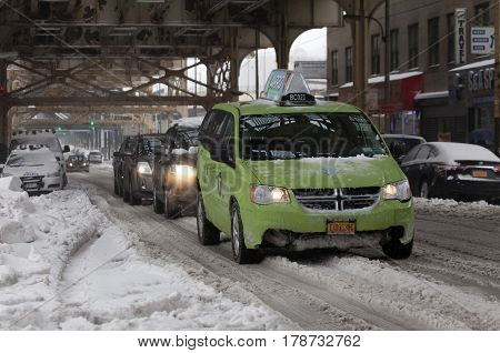 BRONX NEW YORK - MARCH 14: Boro taxi and other autos during snow storm. Taken March 14 2017 in New York.