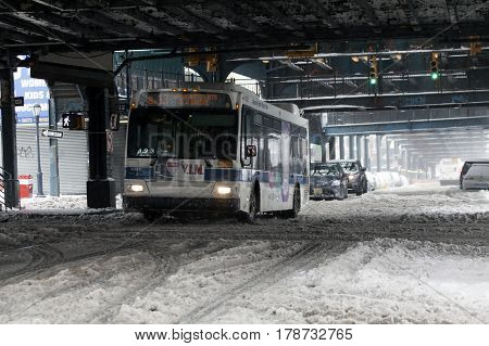 BRONX NEW YORK - MARCH 14: MTA bus rides during snow storm. Taken March 14 2017 in New York.