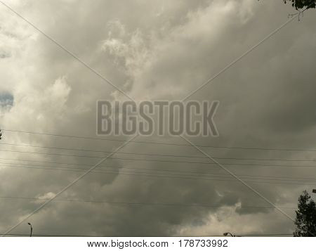 after rain in San Jose, large fluffy clouds loom over the sky