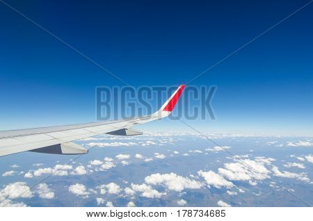 wing airplane with bluesky and clouds from window