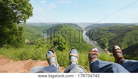 couple relaxing al lookout point cloef with view to saar river bend saarland tourist attraction