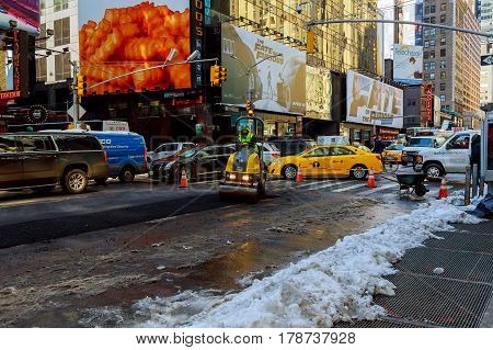 NEW YORK CITY - March 16 2017: road under construction asphalting in progress spring snow