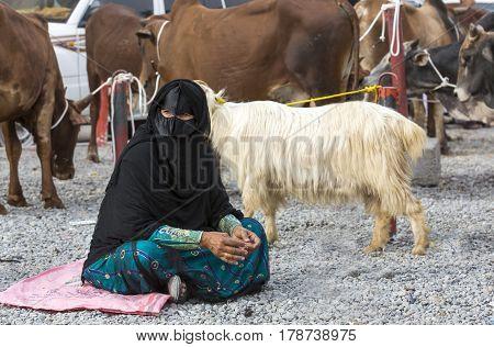 Nizwa Oma 24th March 2017: omani woman at a goat market