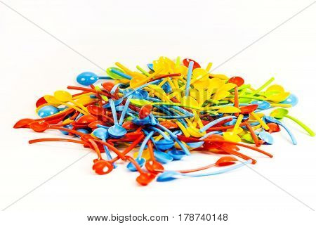 Background of many new colored plastic spoons