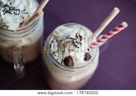 Hot Chocolate Drink  With Milk In Retro Glass Jar (mason Jar), Pink Straw On Wooden Table. Copy Spac