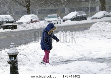 BRONX NEW YORK - MARCH 14: Young girl walks in snow storm. Taken March 14 2017 in New York.