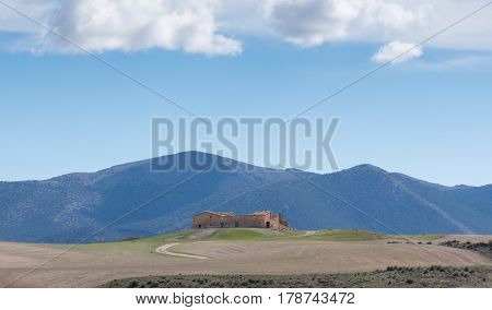 Abandoned house with the Sierra de Maria in the background on a sunny day