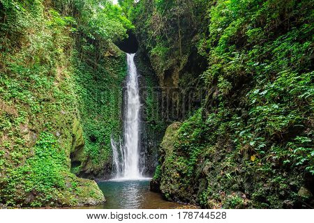 Beautiful waterfall and stones in a rainforest. Bali
