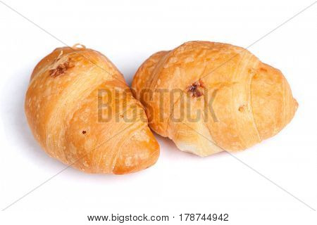 Group of small croissant isolated on white