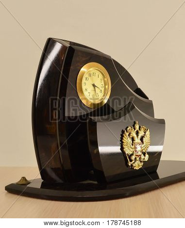 Stand made of marble for paper with mechanical clock