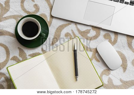 Business Computer, Notebook And Pen With Cell Phone And Coffee On Sofa