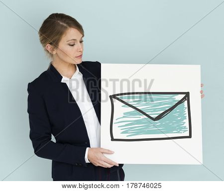 Businesswoman holding placard with email icon