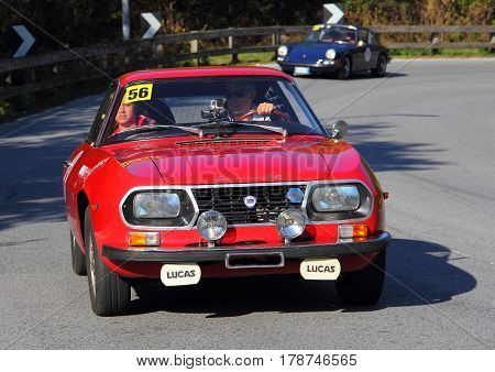Mignanego Italy - September 25th 2015 - Reenactment 18th Pontedecimo Giovi: The Lancia Fulvia Sport 1972 conducted by snack-snack during a timed regularity 'test.