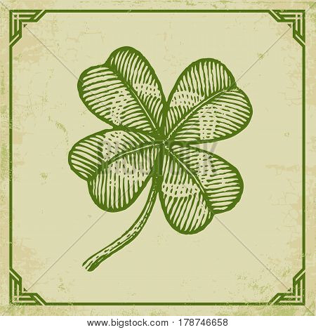 Vector vintage poster with clover for Patrick's day. Green clover on old paper and vintage frame.