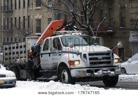 BRONX NEW YORK - MARCH 14: Department of Transit truck with mounted Palfinger knuckle boom crane during snow storm. Taken March 14 2017 in New York.
