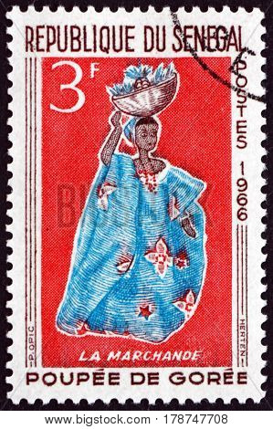 SENEGAL - CIRCA 1966: a stamp printed in Senegal shows Woman Peddling Fruit Doll of Goree circa 1966