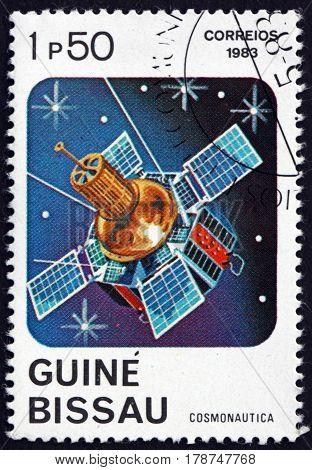 GUINEA-BISSAU - CIRCA 1983: a stamp printed in Guinea-Bissau shows Telecommunications Satellite circa 1983