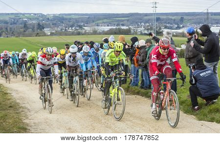 VendomeFrance- March 72016:The cyclists rinding in the peloton on a dirty roadTertre de la Motte in Vendome during the first stage of Paris-Nice 2016.