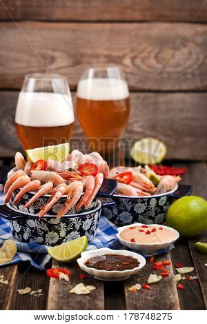 Shrimps Appetizer With Sauces And Glasses Of Beer