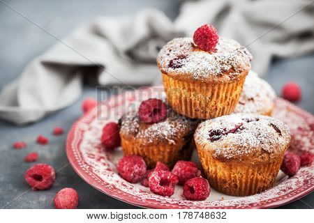 Fresh homemade delicious raspberry muffins  on plate