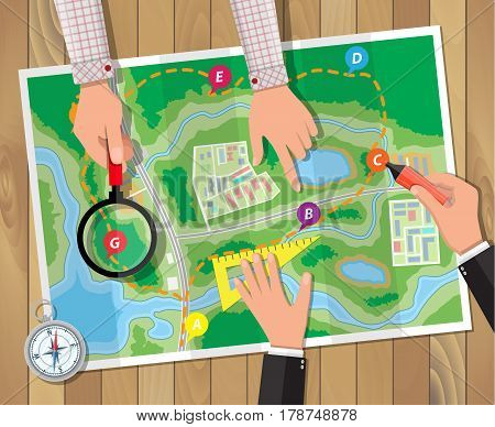 Wooden table with paper map and compass. Marker and magnifying glass in hands. Planning trip. Vector illustration in flat style