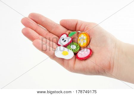 Handmade Toy In The Form Of Fruits And Food Made Of Felt Stretched On A Palm. Close-up Of Crafts Wit