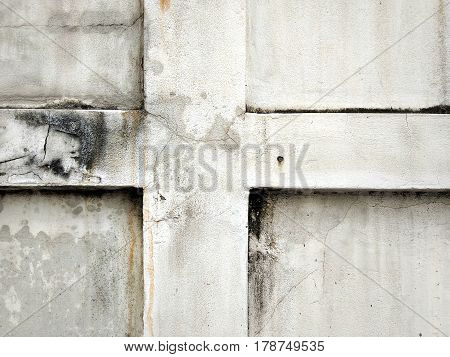 Old cracked plaster on the wall. Grunge concrete texture and background