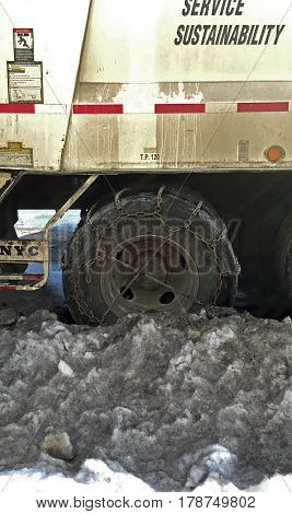 BRONX NEW YORK - MARCH 14: Wheel of Sanitation truck with chains. Taken March 14 2017 in New York.
