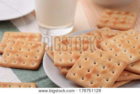 Still life with soda crackers and  milk