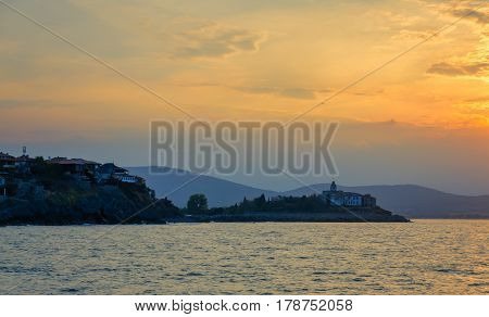panoramic evening view at sunset with dramatic clouds in sozopol, bulgaria