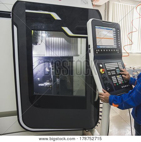 Remote control panel of metal machine - Industrial working manufactory, close up