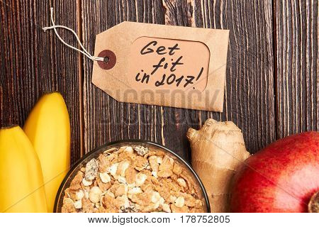 Pomegranate, muesli, bananas and label. Your way to healthy lifestyle.